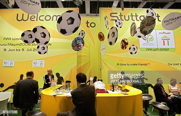Visitors gather information at a stand of the southern city of Stuttgart one of the 2006 Football World Cup hosting cities at Berlin's International...