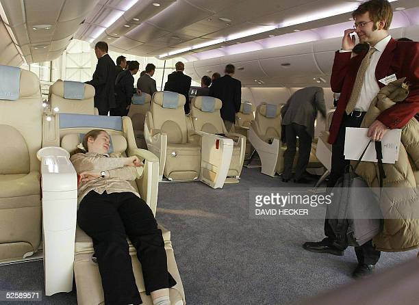 Visitors try out the seats in the cabin of an Airbus A380 the world's biggest ever passenger plane at the Aircraft Interiors Expo fair 05 April 2005...