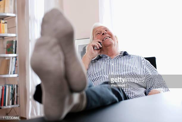 Germany, Wakendorf, Senior man on the phone, smiling