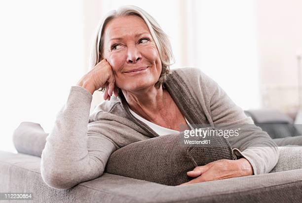 Germany, Wakendorf, Senior woman looking away, smiling