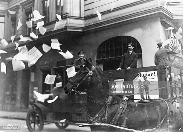 Germany Weimar Republic Dropping pamphlets from a truck campaigning for the Social Democratic Party early January 1919