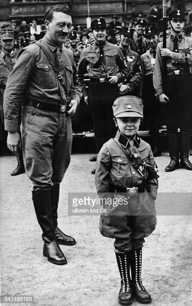 Germany Weimar Republic National socialist movement Adolf Hitler *20041889 Politician Nazi Party Germany Hitler with a small boy in SAuniform at a...