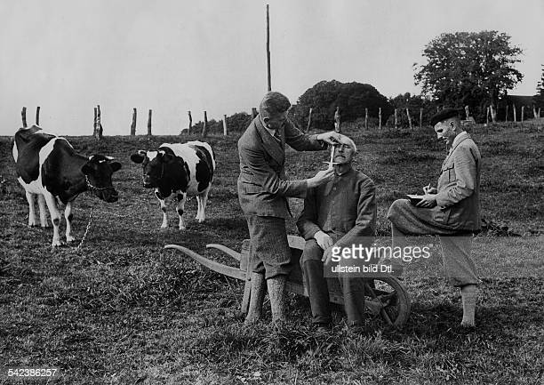 Germany Weimar Republic Staff of the Anthropological Institute of Kiel University are measuring heads and faces of villagers in North Germany 1932
