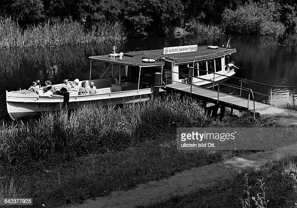Germany West Berlin steamer 'GartenfeldSaatwinkelTegelort' at the landing stage at the Spandau canal 1962 Photographer Gert KreutschmannVintage...