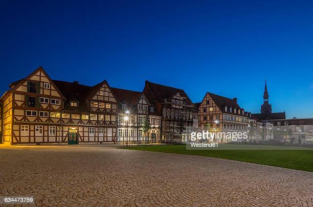 Germany, Wolfenbuettel, Half-timbered houses and Trinity Church in the evening