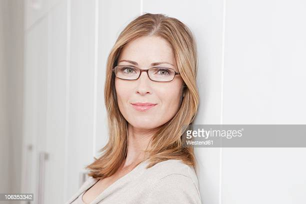 Germany, Woman with glasses, smiling, portrait