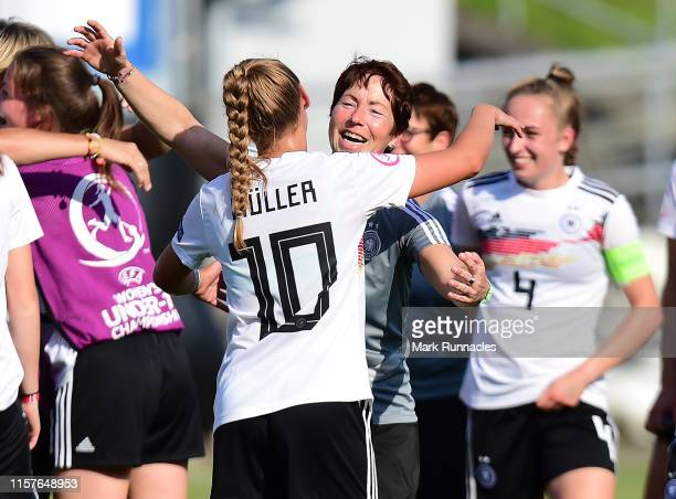 Germany Women's U19 head coach Maren Meinert embraces Marie Muller of Germany at the final whistle during of the UEFA Women's U19 European...