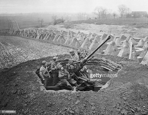 Yanks Man Antiaircraft Gun Near Siegfried Line Members of a U S Ninth Army antiaircraft unit are shown on the alert for enemy aircraft Dragons teeth...