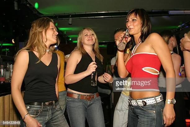 Young persons at nightlife On the dancefloor of a discotheque alcoholic mixed drinks Smirnoff Ice