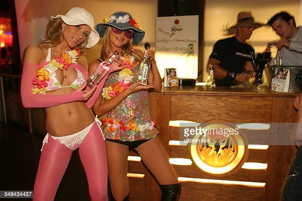 Young persons at nightlife Promotion two women promote the alcoholic mixed drink Bacardi Rigo