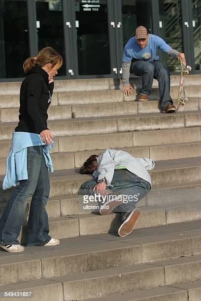 Young persons in their free time Friends are skateboarding a young man being injured after falling on the stairs