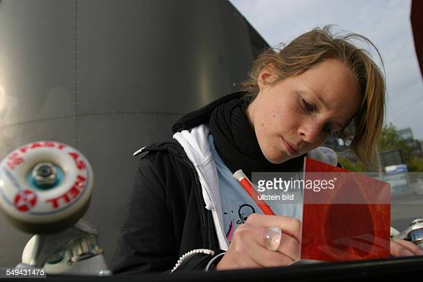 Young persons in their free time Portrait of a young woman writing a card