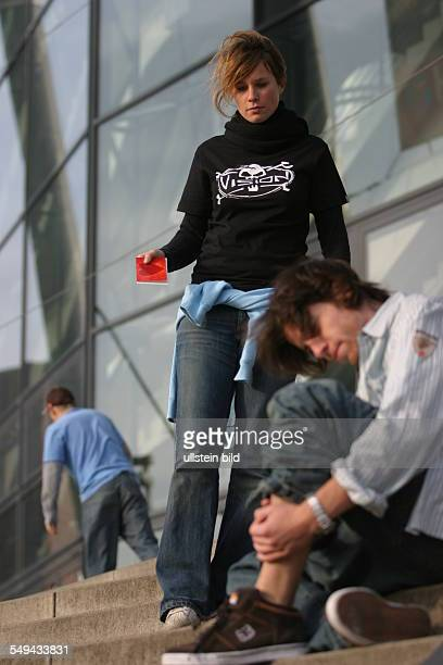 Young persons in their free time Skateboarding situation between a young couple