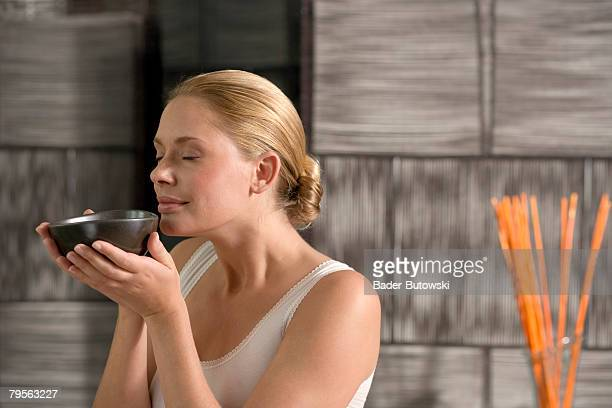 germany, young woman holding tea bowl, close-up - tea hot drink stock pictures, royalty-free photos & images