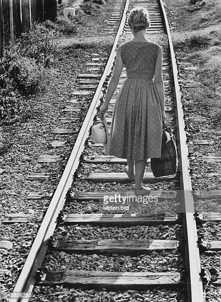 Germany young woman is walking on railway tracks 1950s