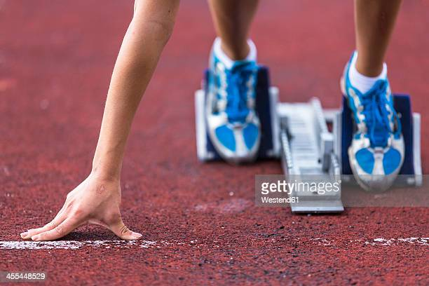germany, young woman running from sprint start - beginnings stock pictures, royalty-free photos & images