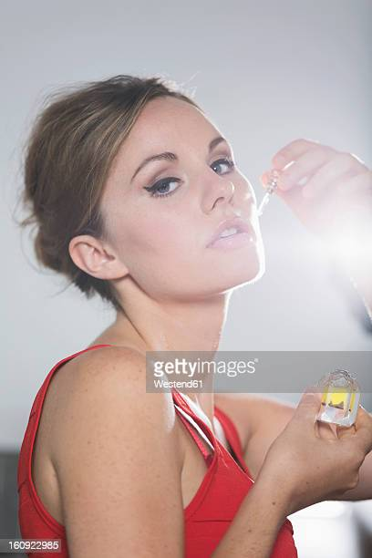 Germany, Young woman smelling truffle oil