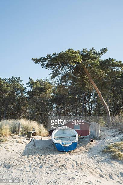 Germany, Zempin, hut and rowing boat on the beach dunes