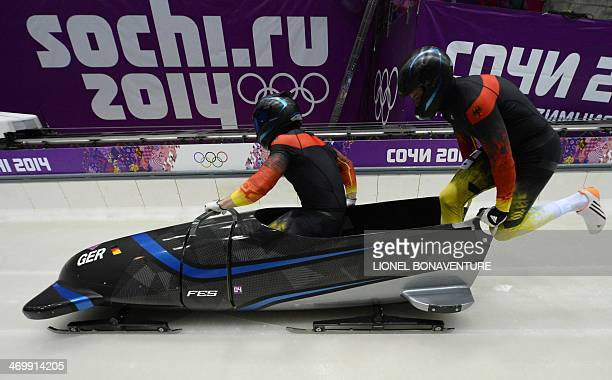 Germany1 twoman bobsleigh pilot Francesco Friedrich and brakeman Jannis Baecker compete in the Bobsleigh Twoman Heat 3 at the Sliding Center Sanki...