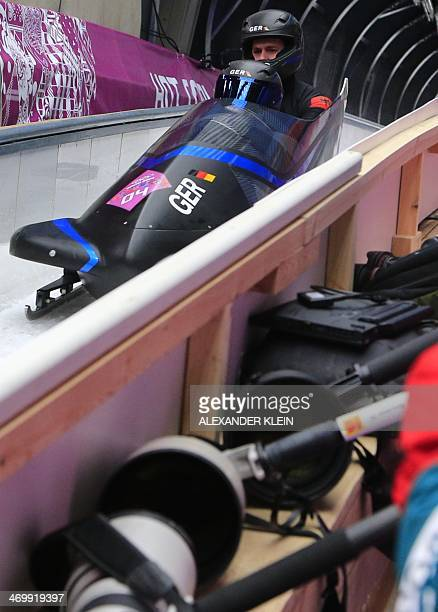Germany1 twoman bobsleigh pilot Francesco Friedrich and brakeman Jannis Baecker arrive in the finish area after the Bobsleigh Twoman Heat 3 at the...