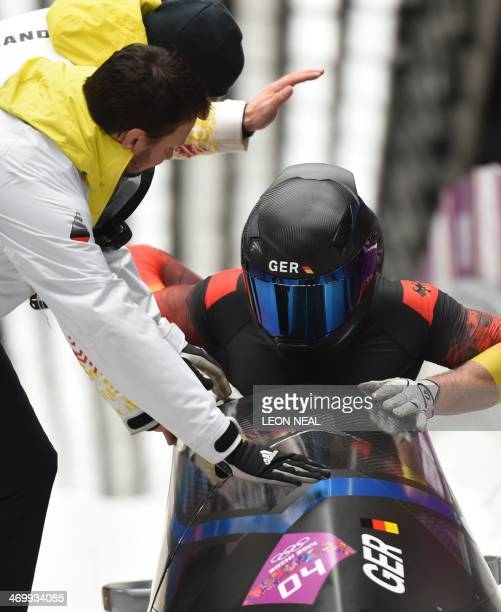Germany1 twoman bobsleigh pilot Francesco Friedrich and brakeman Jannis Baecker arrive in the finish area after the Bobsleigh Twoman Heat 4 and final...