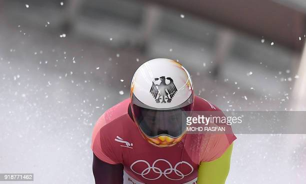 Germany's Alexander Gassner slows down at the end of the mens's skeleton heat 3 run during the Pyeongchang 2018 Winter Olympic Games, at the Olympic...
