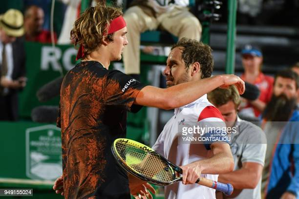 Germany's Alexander Zverev and France's Richard Gasquet shake hands at the at the end of their men's single tennis match at the MonteCarlo ATP...
