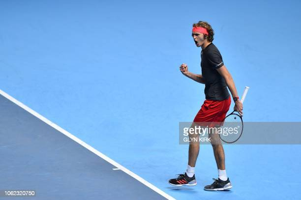 Germany's Alexander Zverev celebrates after a point against US player John Isner in their men's singles roundrobin match on day six of the ATP World...