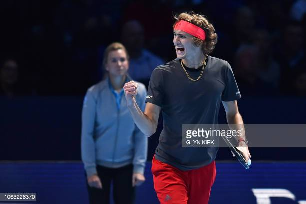 Germany's Alexander Zverev celebrates after breaking the serve of Serbia's Novak Djokovic during their men's singles final match on day eight of the...