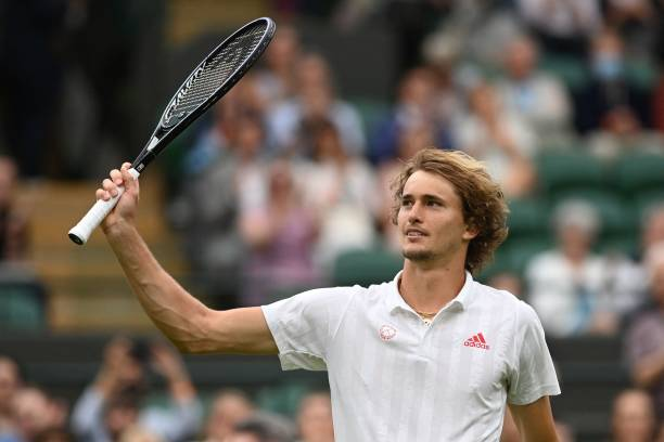 Germany's Alexander Zverev celebrates after defeating Netherland's Tallon Griekspoor during their men's singles first round match on the second day...