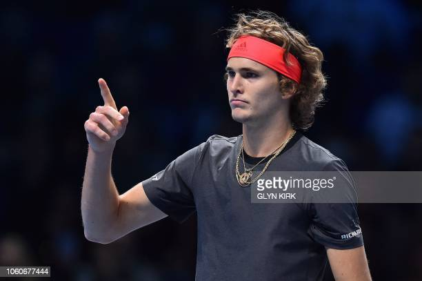 Germany's Alexander Zverev celebrates after winning the first set against Croatia's Marin Cilic during their men's singles roundrobin match on day...