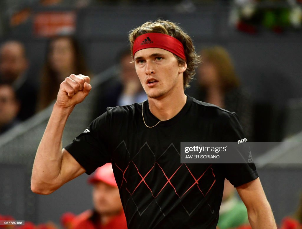 Germany's Alexander Zverev celebrates defeating Canada's Denis Shapovalov during their ATP Madrid Open semi-final tennis match at the Caja Magica in Madrid on May 12, 2018.