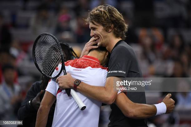 Germany's Alexander Zverev embraces Serbia's Novak Djokovic after their men's singles semifinals match at the Shanghai Masters tennis tournament on...