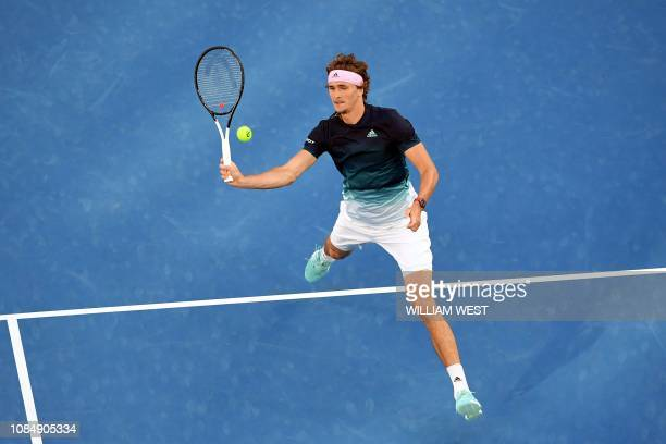 TOPSHOT Germany's Alexander Zverev hits a return against Australia's Alex Bolt during their men's singles match on day six of the Australian Open...