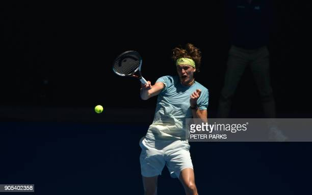 Germany's Alexander Zverev hits a return against Italy's Thomas Fabbiano during their men's singles first round match on day two of the Australian...