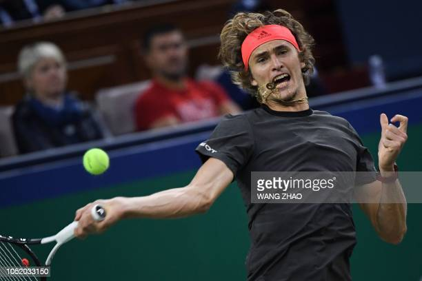 Germany's Alexander Zverev hits a return against Serbia's Novak Djokovic during their men's singles semifinals match at the Shanghai Masters tennis...