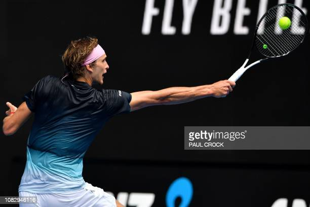 Germany's Alexander Zverev hits a return against Slovenia's Aljaz Bedene during their men's singles match on day two of the Australian Open tennis...
