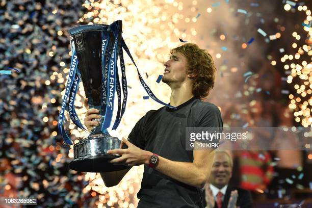 Germany's Alexander Zverev holds up the trophy after beating Serbia's Novak Djokovic in their men's singles final match on day eight of the ATP World...