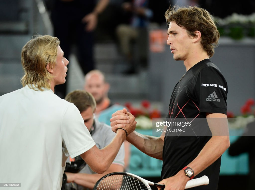 Germany's Alexander Zverev (R) is congratulated by Canada's Denis Shapovalov during their ATP Madrid Open semi-final tennis match at the Caja Magica in Madrid on May 12, 2018.