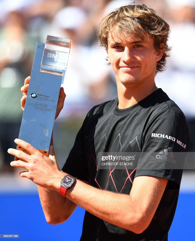 Germany's Alexander Zverev poses with the trophy after defeating his compatriot Philipp Kohlschreiber in their final match at the ATP Tennis Open in Munich, southern Germany, on May 6, 2018.
