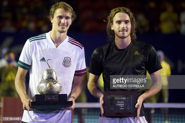 Germany's Alexander Zverev poses with the trophy alongside Greece's Stefanos Tsitsipas, after defeating him and winning Mexico ATP Open 500 men's...