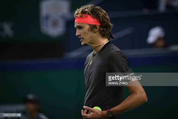 Germany's Alexander Zverev prepares to serve against Serbia's Novak Djokovic during their men's singles semifinals match at the Shanghai Masters...