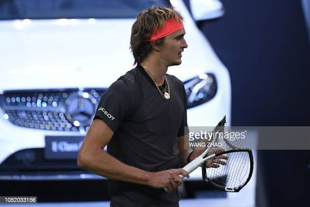Germany's Alexander Zverev reacts after losing a point against Serbia's Novak Djokovic during their men's singles semifinals match at the Shanghai...