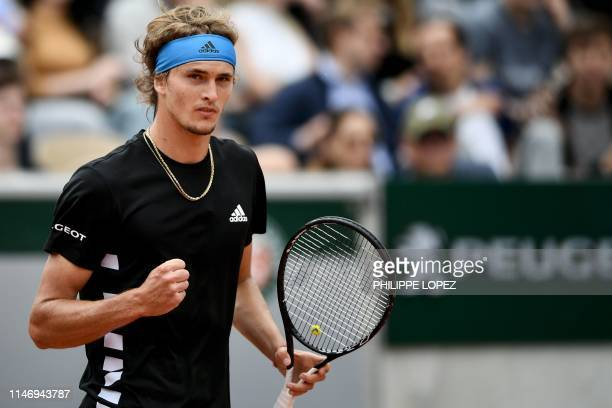 Germany's Alexander Zverev reacts as he plays against Sweden's Mikael Ymer during their men's singles second round match on day five of The Roland...