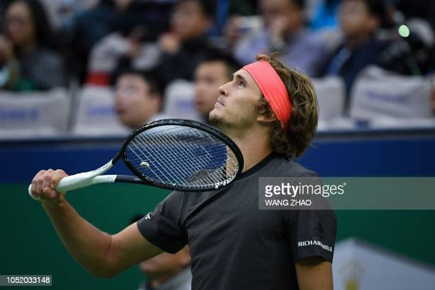 Germany's Alexander Zverev reacts to a point against Serbia's Novak Djokovic during their men's singles semifinals match at the Shanghai Masters...