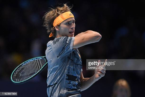 Germany's Alexander Zverev returns against Austria's Dominic Thiem during the men's singles semifinal match on day seven of the ATP World Tour Finals...