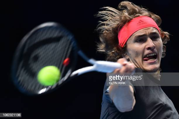 Germany's Alexander Zverev returns against US player John Isner in their men's singles roundrobin match on day six of the ATP World Tour Finals...