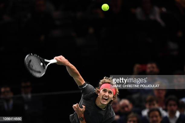 Germany's Alexander Zverev returns serves the ball to Russia's Karen Khachanov during their men's singles quarterfinal tennis match on day five of...