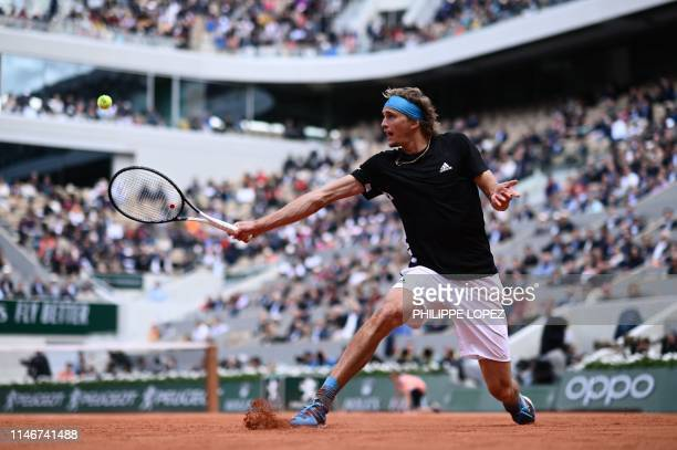 Germany's Alexander Zverev returns the ball to Australia's John Millman during their men's singles first round match on day three of The Roland...