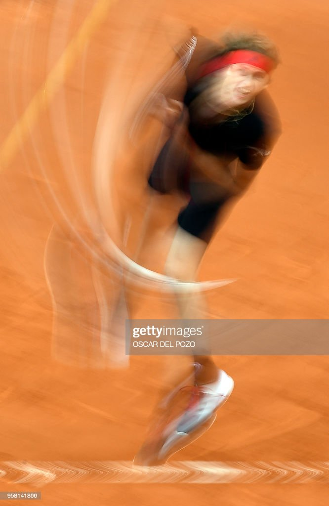 Germany's Alexander Zverev returns the ball to Austria's Dominic Thiem during their ATP Madrid Open final tennis match at the Caja Magica in Madrid on May 13, 2018.